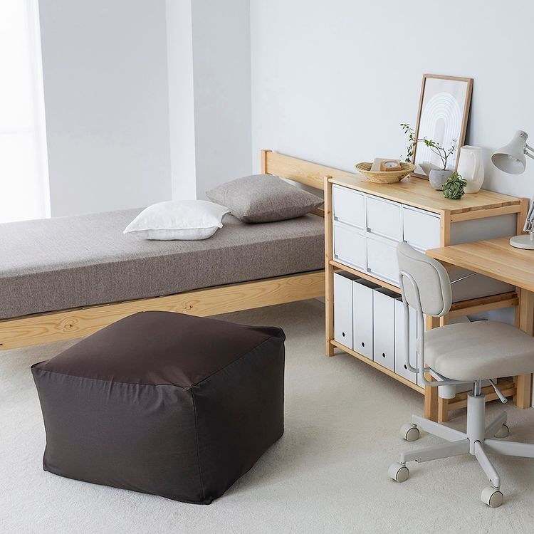 single bed with small closet and desk