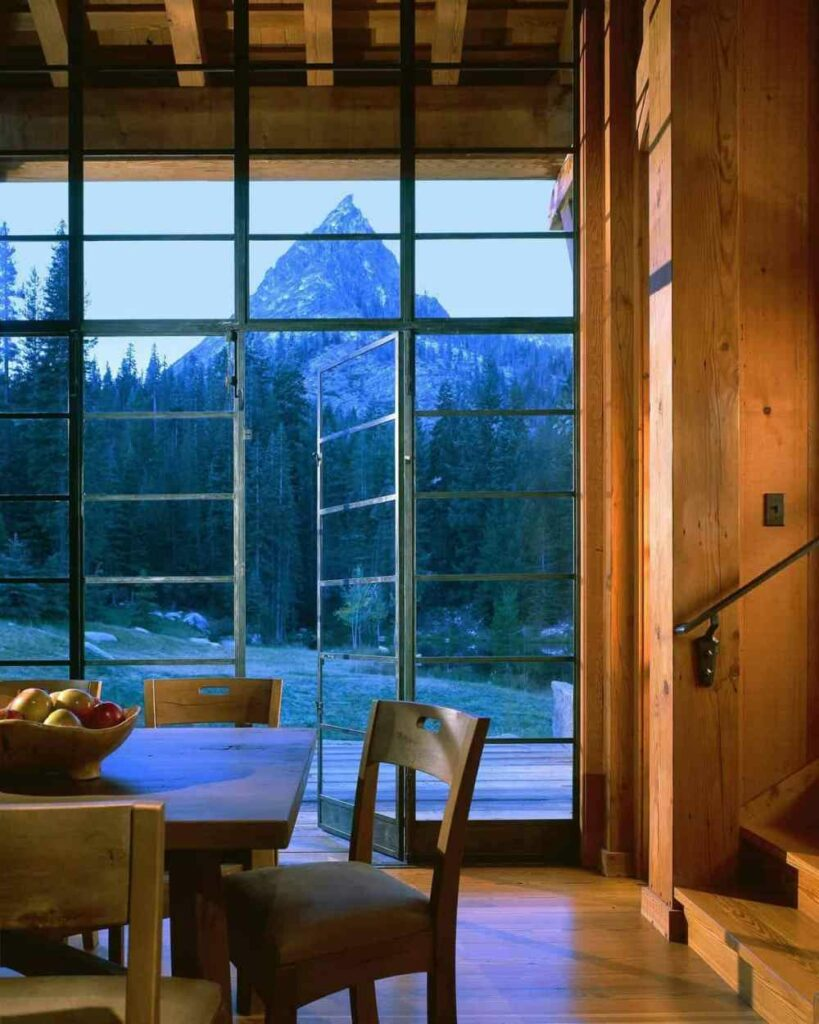 Large glass doors and windows expose the living area to the majestic views