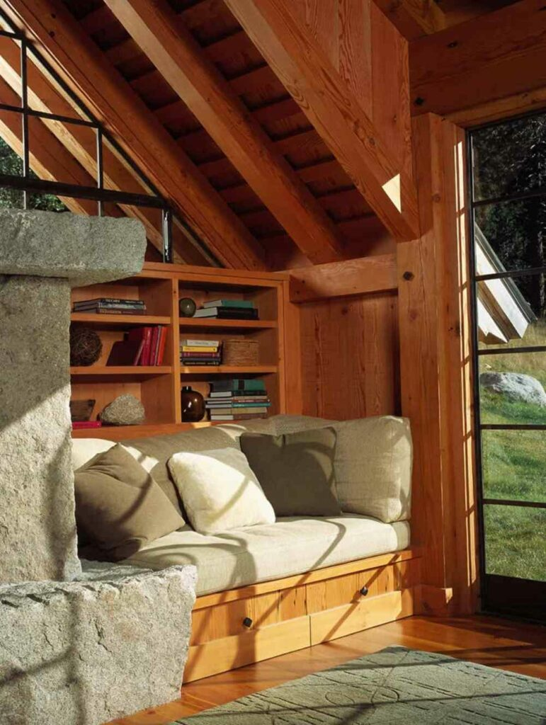 The daybed can extend into a large sleeping area and has storage for bedding underneath