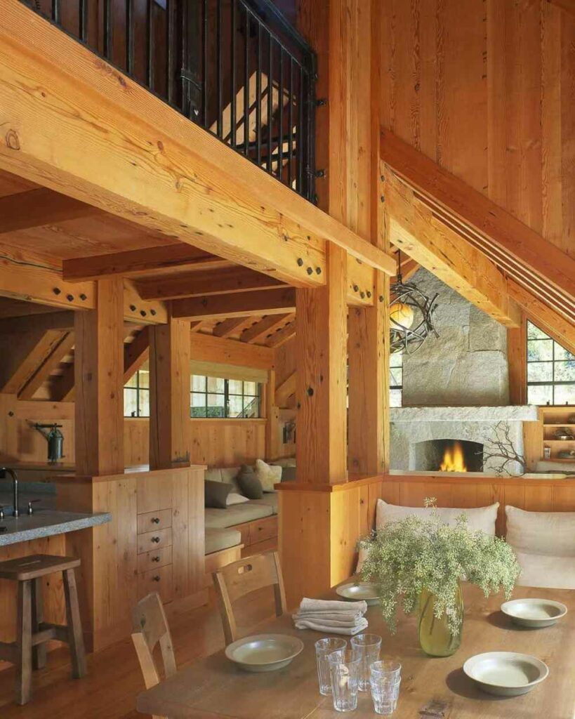 The cabin is heated by a wood-burning fireplace and a wood stove