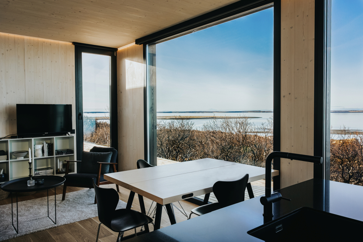 The large full-height windows balance out the small footprint of the house