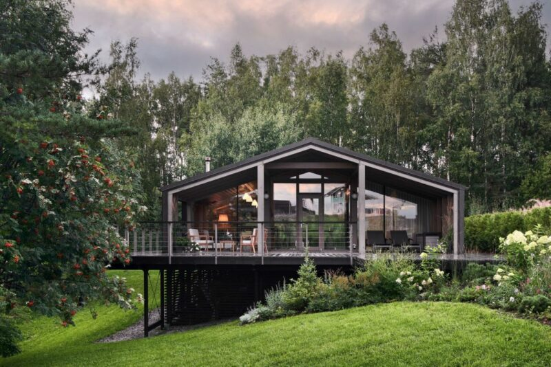 A Rustic Modular House On Top Of A Small Forest Slope