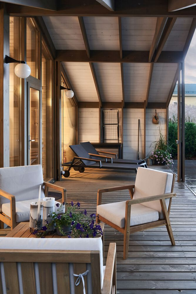 The roof and exterior walls extend partially onto the deck forming a sheltered outdoor nook