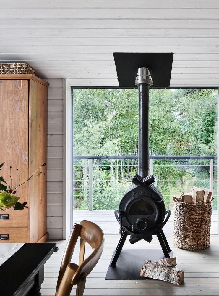 This freestanding metal fireplace makes the living area extra warm and cozy